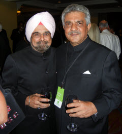 Elegant gowns and black tie attire reveal the many faces of the tea industry as attendees C.S. Bedi of Rossell Tea, India and Krishan Katyal of J. Thomas & Co. honor retiring Tea Association of the USA President Joe Simrany.