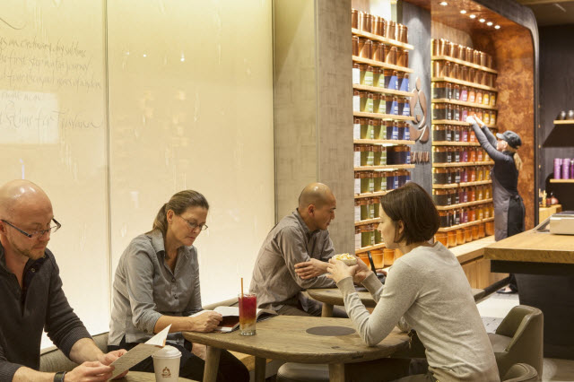 Charles Cain, left, heads Concept Development for Teavana's new stores.
