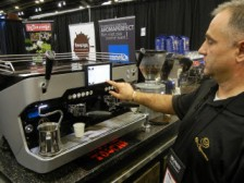 Vladimir Martinov demonstrates the latest Reneka Espresso machine from Alpha Cappuccino.
