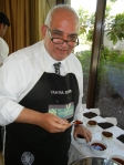 Golden Leaf India Judge Yahya Beyad, owner of Britannia Teas stands over the spittoon.